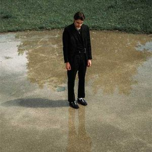 depressed young man standing alone