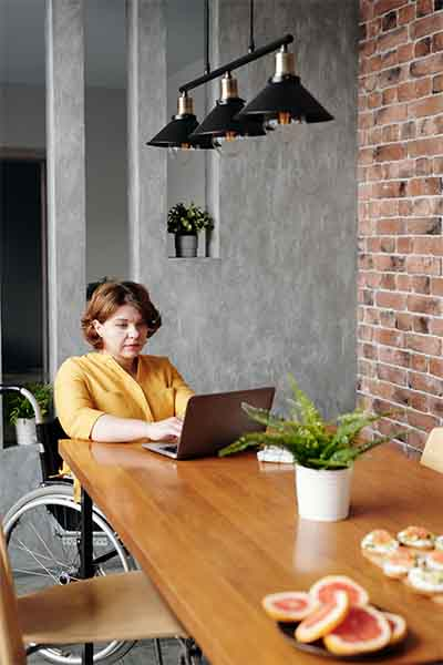 lady with laptop on online counselling session